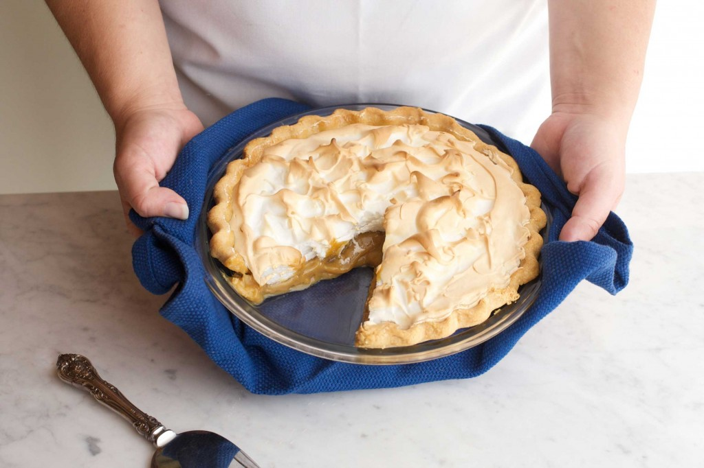 Nancie McDermott holding a butterscotch pie with slice taken out